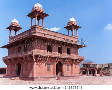 The Hall of Private Audience at Fatehpur Sikri palace and fort near India's Agra. Two story palace in red sandstone and white domes against blue skies. - stock photo