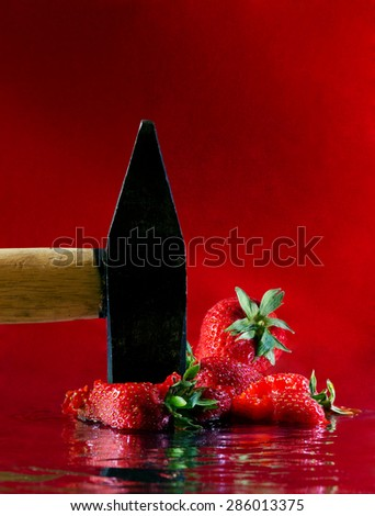 The hammer crushed strawberries