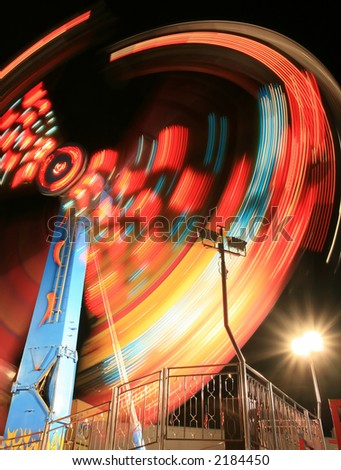 The Hammer ride at the county fair. - stock photo