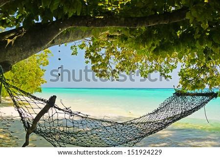 The Hammock under the tree on the beach , Rok Island , Lanta National Park , Krabi , Thailand - stock photo