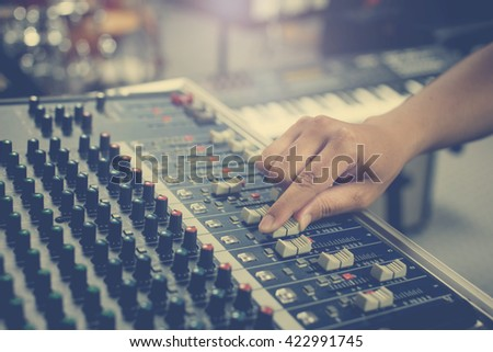 The hand adjust sound audio mixer board - stock photo