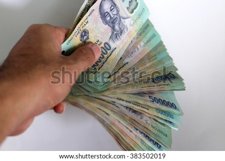 The Hand get Money Vietnam dong with white Background - Way to succesfull, Earn Money - stock photo
