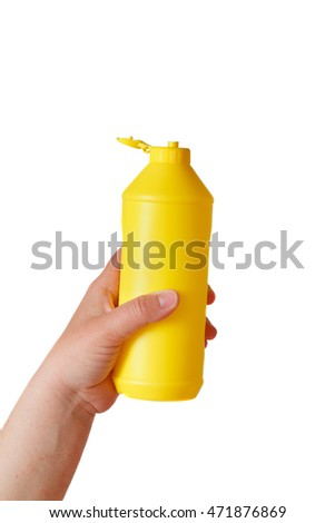the hand holding yellow plastic bottle isolated on white background
