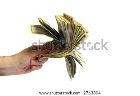 The hand holds some dollars. - stock photo