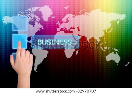 The hand is pressing the business button  on a touch screen interface - stock photo
