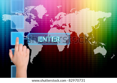 The hand is pressing the Enter button  on a touch screen interface - stock photo