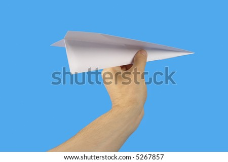 The Hand, keeping paper plane, on turn blue the background.