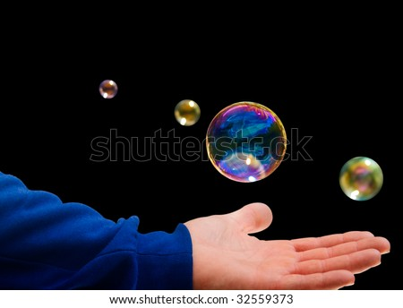 The Hand of a Girl plays with a Soap bubble - stock photo