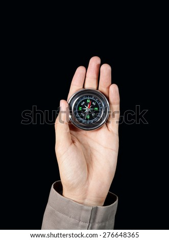 The hand of a man holding a magnetic compass, Directional concept - stock photo