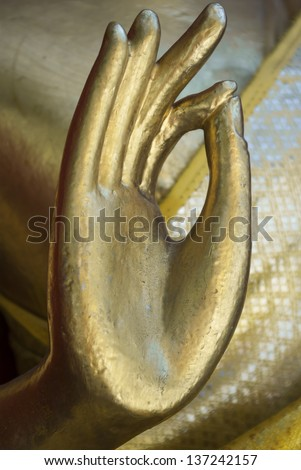 The hand of golden Buddha statue at buddhist temple, Chiang Mai, Thailand