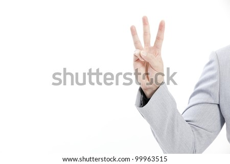 The hand of the businessman showing various signs - stock photo