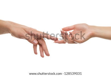 The hand of the man and the woman's hand a gentle touch - stock photo