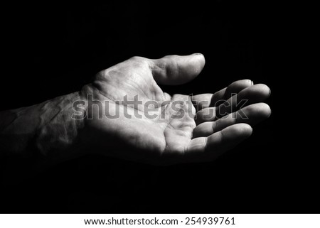 The hand of the old man in a low key. black and white - stock photo