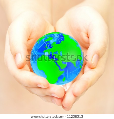 The hand of the person holds globe