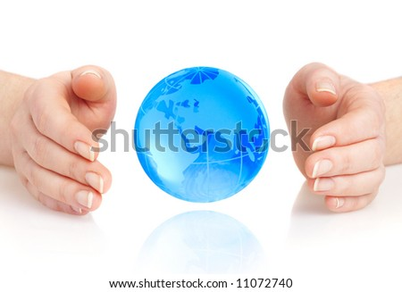 The hand of the person holds globe on a white background