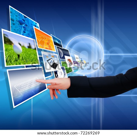 The hand on the flow of several  images - stock photo