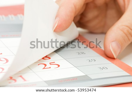 The hand overturns calendar sheet
