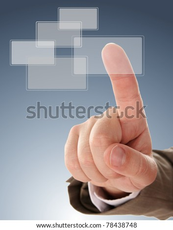 The hand pressing one of the buttons on blue background - stock photo