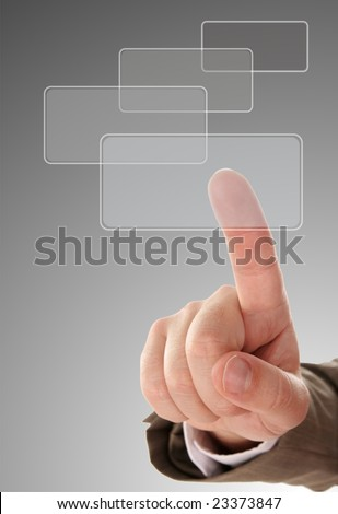 The hand pressing one of the buttons on grey background - stock photo