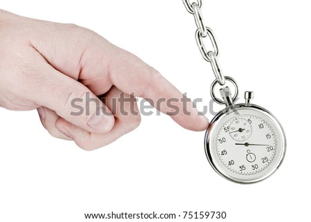 The hand shifts a pendulum consisting of a stop watch on a chain. Isolated on white [with clipping path]. - stock photo