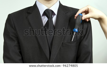 the hand that takes out of his pocket, tool - stock photo