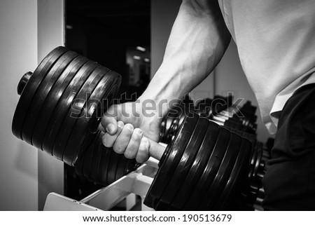 the hand with the dumbbell