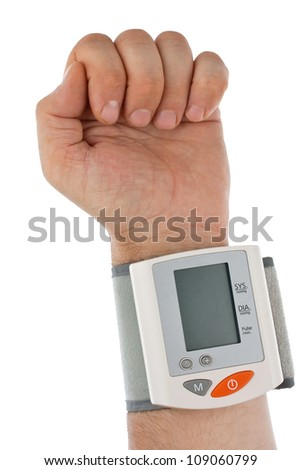 The hand with the tonometer. Isolated on white background - stock photo