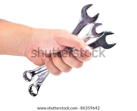 The hand with the wrench. Isolated on white background - stock photo