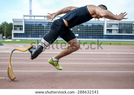 The handicap athlete preparing to start running - stock photo