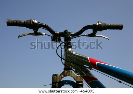 The handle bars of a mountain bike - stock photo