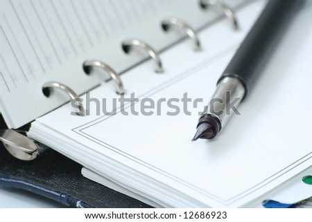 The handle lays on a notebook