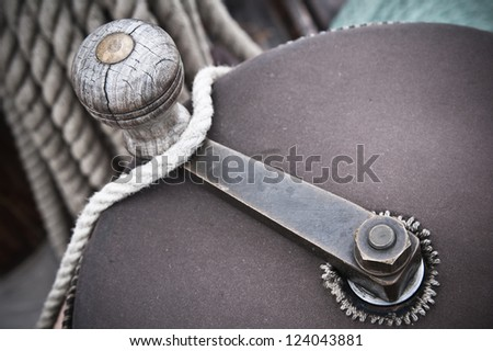 The handle of a drum for winding a rope,  on an ancient sailing vessel - stock photo