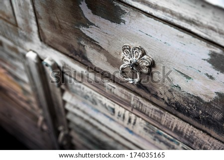 the handle of an old rustic cupboard, a drawer - stock photo