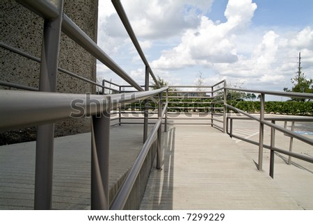 The handrails of a well designed handicap access ramp. - stock photo