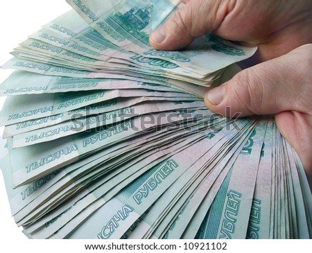 The hands holding many of the Russian banknotes - stock photo