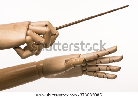 The hands of a conductor. One hand holds the baton, the other hand indicates the nuances. On white background.