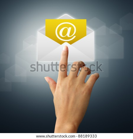 The hands of a feminine touch on the envelope and mail. - stock photo