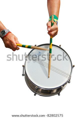 The hands of a percussionist playing his drum isolated in white - stock photo