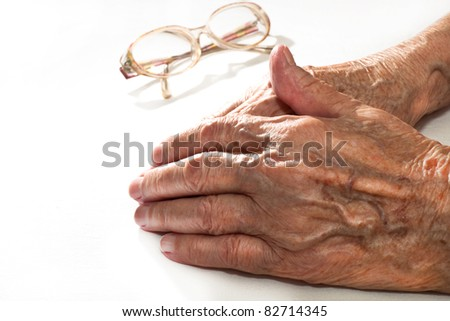the hands of an elderly woman - stock photo