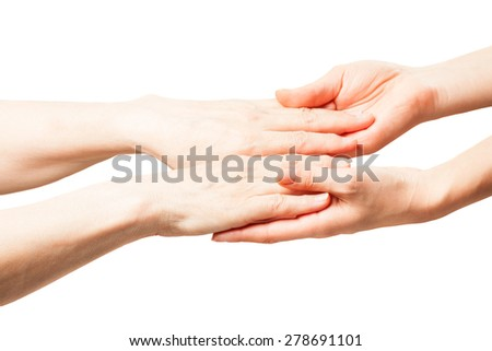 the hands of an old man with wrinkles . hands touch her daughter and mother. manifestation of tenderness and love.