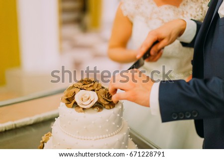 who cuts the wedding cake first white dress groom standing on stock photo 517210813 27429