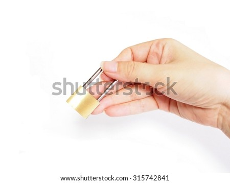 The hands of the women with a padlock - stock photo