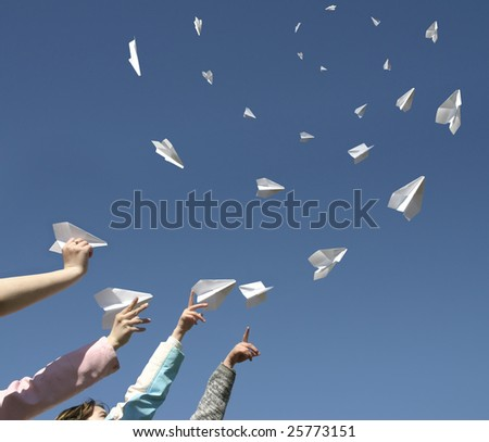The Hands throw upwards paper airplanes. - stock photo
