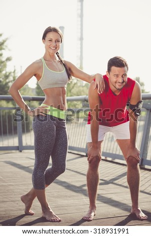 The handsome sportsman and the attractive woman resting in color effect
