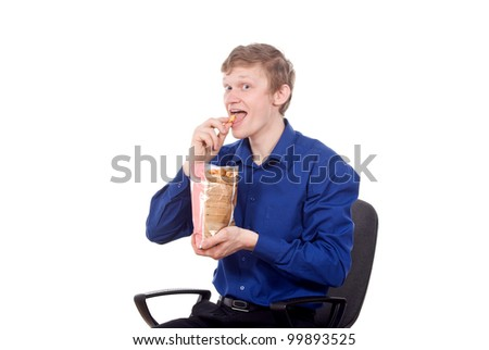 the handsome young man sitting on a chair and eat chips isolated on white background - stock photo