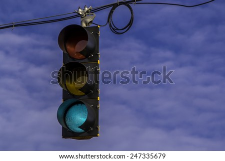 The hanging street light signal. - stock photo