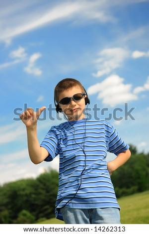 The happy boy in headphones-3 - stock photo