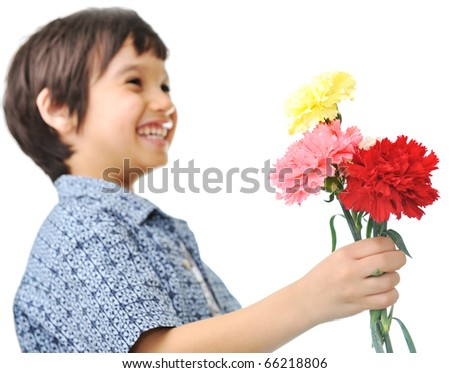 The happy boy with a bouquet of tulips