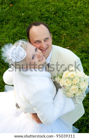 The happy bride and groom looking up; wedding day - stock photo