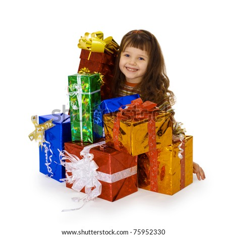 The happy child and the big heap of gifts on birthday - stock photo